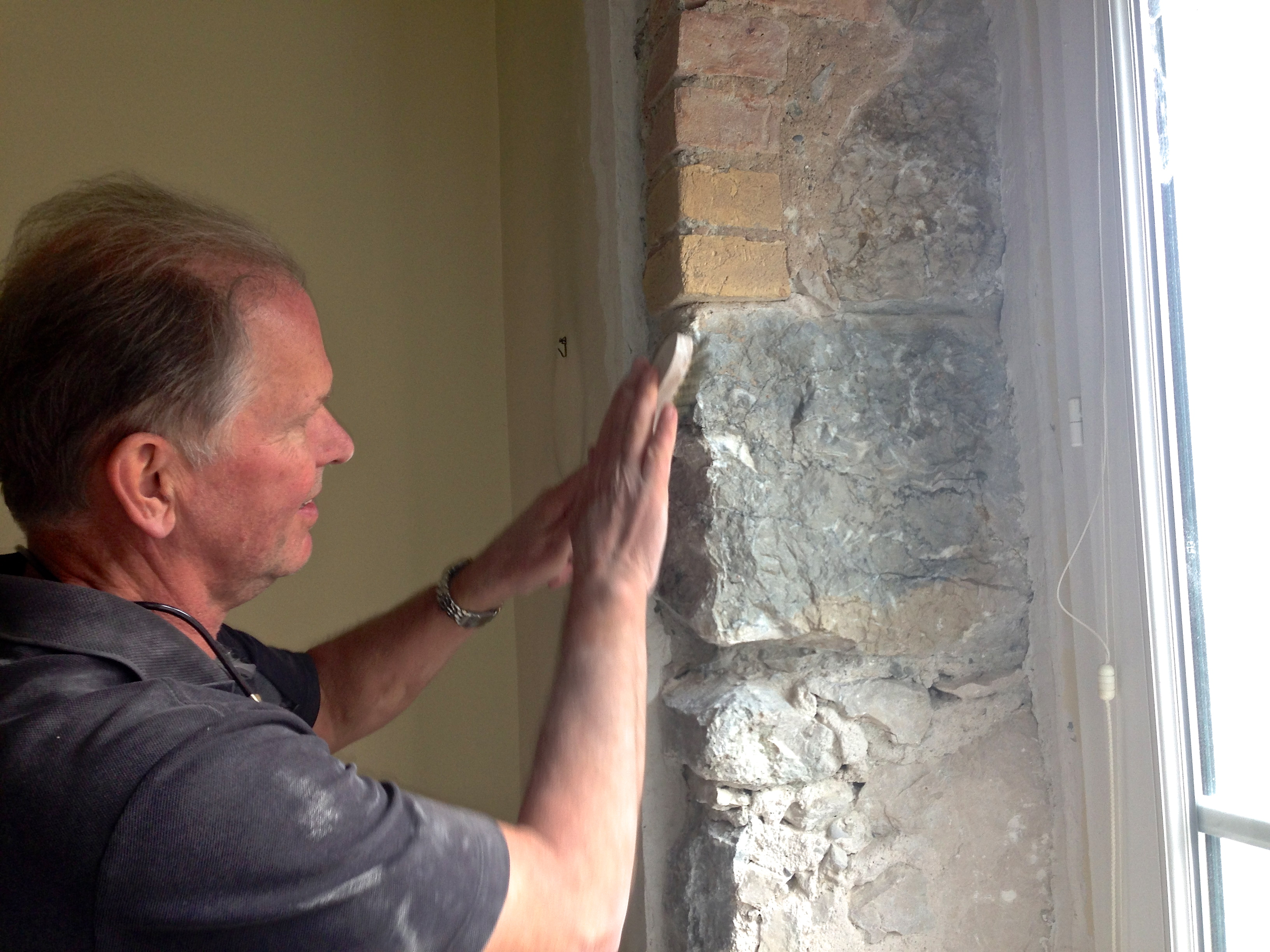Cleaning up rocks and bricks around the windows